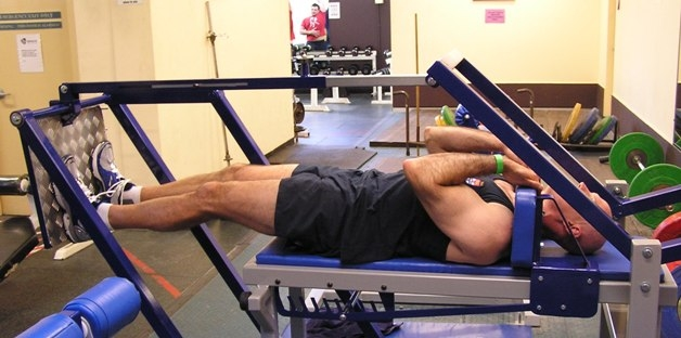 Martin Harland demonstrates the fully extended position on the MyoThrusta hip and knee extensor strength developer