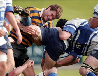 Sydney University Colts forward Ben McCalman completing a tackle